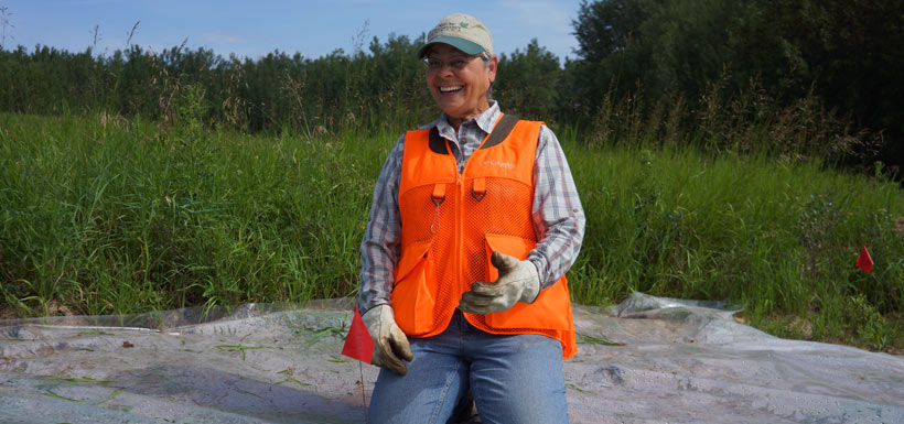 Golden Glove volunteer award recipient Denise Harris all smiles while planting native species. (Photo by NCC)