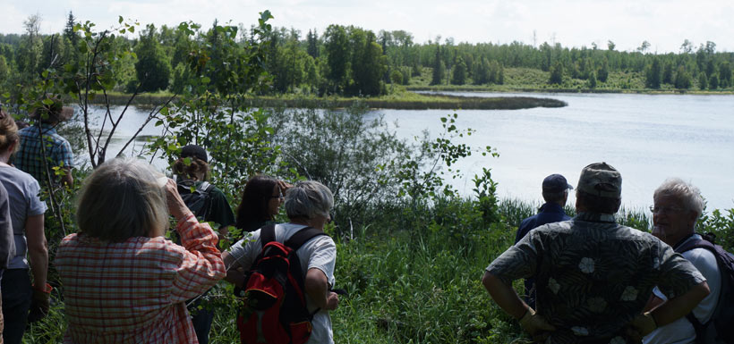 After a day of hard work, Conservation Volunteers relax with bird-watching at Gambling Lake. (Photo by NCC)