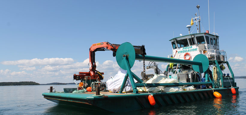 Barge loaded with garbage collected during the Simpson Island clean up (Photo by NCC)
