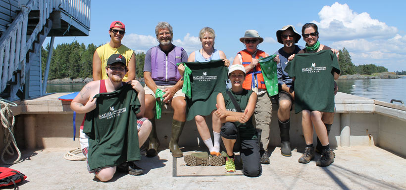 Conservation Volunteers all smiles after a day out on Simpson Island cleaning the shorelines (Photo by NCC)