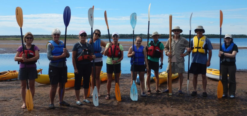 Conservation Volunteers with their kayaks and paddles (Photo by NCC)