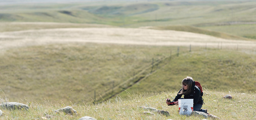 Volunteer taking photo of beautiful landscape, SK (Photo by Michael Bell)