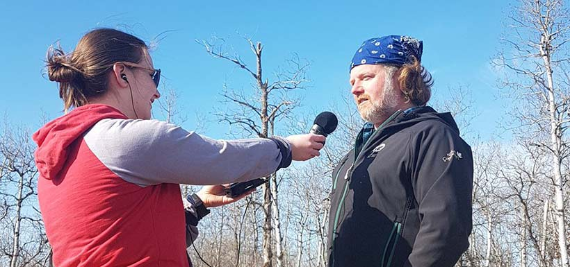 Tiffany Cassidy interviews Cary Hamel about Poweshiek skipperlings (Photo by NCC)