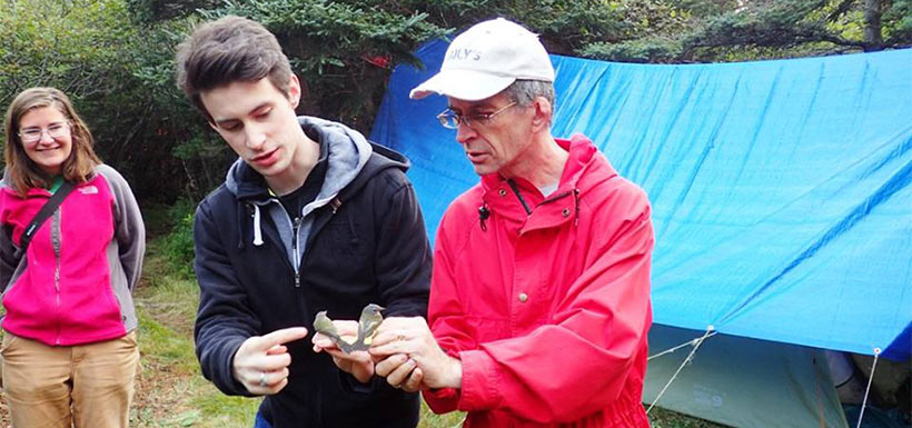 Describing the banded birds at the Brier Island Bird Migration Station. (Photo by NCC)