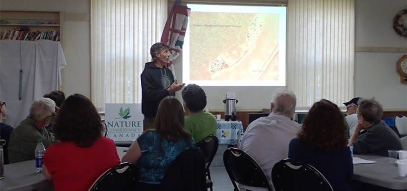 Nick Hill describes the Big Meadow Bog restoration plan. (Photo by NCC)