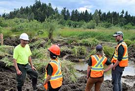 Wetland restoration expert Tom Biebighauser talks to NCC staff about the wetland restoration process. (Photo by NCC)