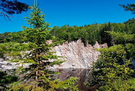 The steep gypsum cliffs, lake and mature forest that served as a great view during lunch. (Photo by NCC)