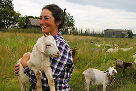 Jeanette Hall with goat (Photo by Molly Dube)