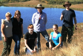 NCC staff and volunteers tackling invasive species at Collins Property, Red Deer River Natural Area, AB (Photo by NCC)