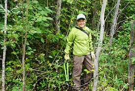 Pat Shea Smith, volunteer in the forest with loppers, 2014 CV Event (Photo by NCC)