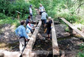 Elk Valley Alliance start fixing the bridge (Photo by EVA)