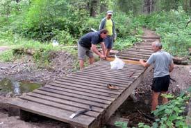 Elk Valley Alliance fixing the bridge (Photo by EVA)