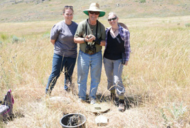 Lauren Meads, Jim Wyse and Barb Pryce visit a burrow (front). (Photo by Michelle Dano)