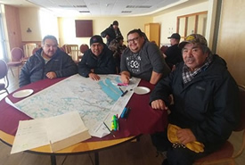 Cree Tallymen from the community of Mistissini map cultural features to help develop proposals for protected areas of significance to the Crees and the Cree way of life (Photo by NCC)