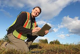 Volunteer Adam Cheeseman in the field, near Sackville, New Brunswick (Photo by Mike Dembeck)
