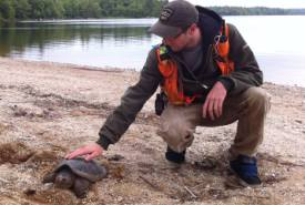 Josh Noseworthy and a snapping turtle, Tusket River Headwaters Nature Reserve, NS (Photo by Frank Merill)