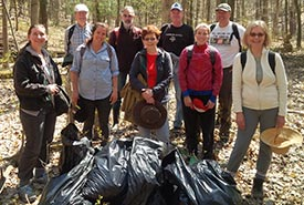 Conservation Volunteers at spring 2017 garlic mustard pull, Happy Valley Forest, ON (Photo by NCC)