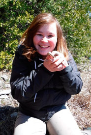 Esme Batten, NCC's coordinator, conservation biology for the Saugeen Bruce Peninsula, holds a young queen snake. NCC's queen snake project has multiple permits to complete these project, such as Animal Care Permits and Wildlife Science Collectors Authorization, among others. These permits allow us to carefully handle species in order to collect important data about health, diet and population dynamics. We employ rigorous sterile techniques, and only handle animals when absolutely necessary. (Photo by NCC)