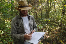 NCC reptile and amphibian technician, Louis Gagnon, records data during field variations of species at risk habitat models (Photo by NCC)