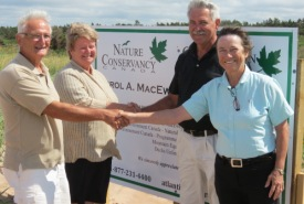 Garry MacEwen, National Revenue Minister Gail Shea, Jim MacEwen and NCC Program Manager Diane Griffin unveil Errol A. MacEwen Nature Reserve, PEI (Photo by NCC)