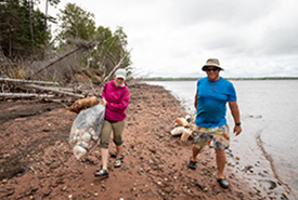 Lanna Campbell and volunteer John Nyren clean up Murray Harbour nature reserves (photo credit: Stephen DesRoches)