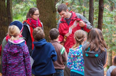 Exploring the forest at Nature Day, Covey Hill, QC (Photo by HSBC Canada Bank)
