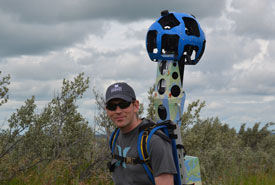 NCC's Cameron Wood hikes with the Google Trekker at Fairy Hill. (Photo by NCC)