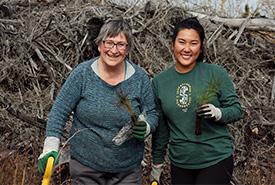 Volunteers planting trees at Meeting Lake 03 (Photo by NCC)